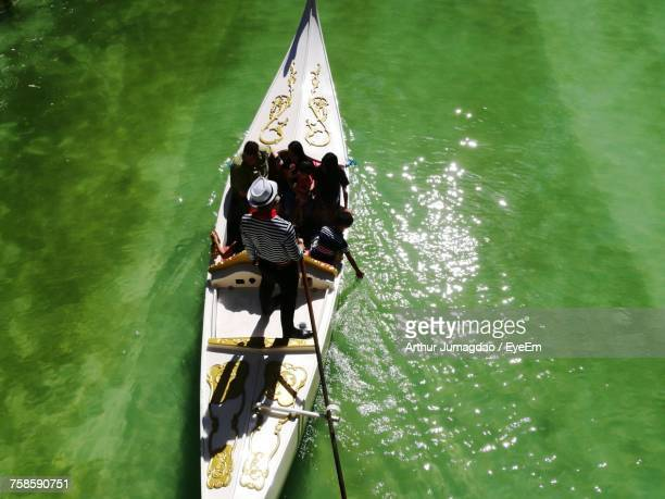 High Angle View Of People On Gondola