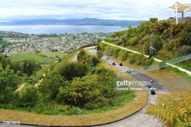 high angle view of people on race track against sky - rotorua stock pictures, royalty-free photos & images