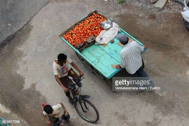 high angle view of people on road - market trader stock pictures, royalty-free photos & images
