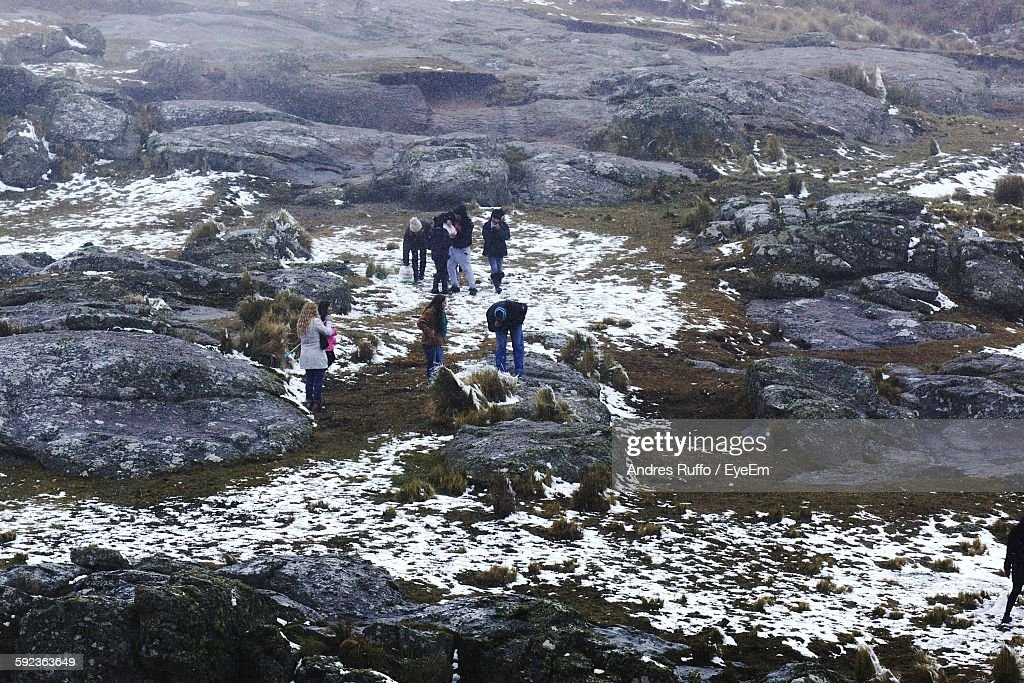 High Angle View Of People On Rocky Landscape During Winter : Stock Photo