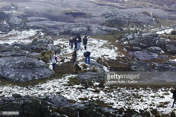 High Angle View Of People On Rocky Landscape During Winter