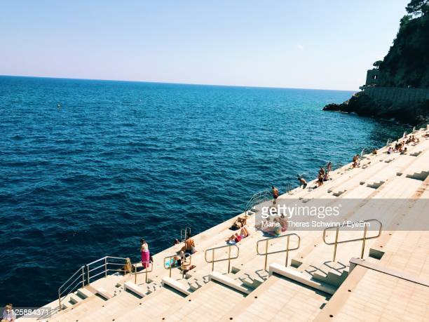 high angle view of people on sea shore against clear sky - monaco photos et images de collection