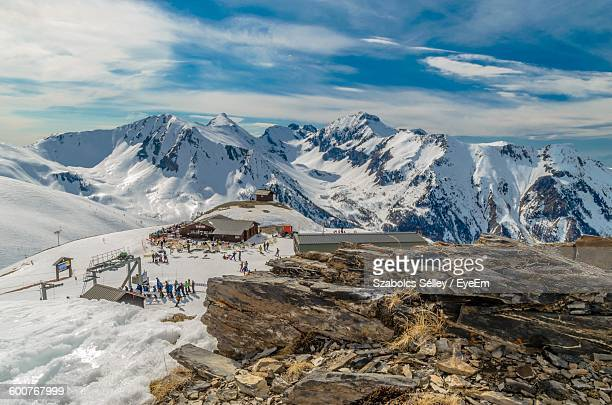 high angle view of people on snowcapped mountain at les orres - embrun stock pictures, royalty-free photos & images