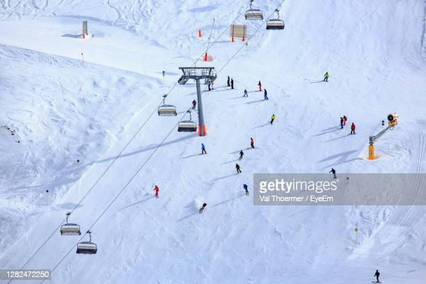 high angle view of people on snowcapped mountain - val thoermer stock-fotos und bilder