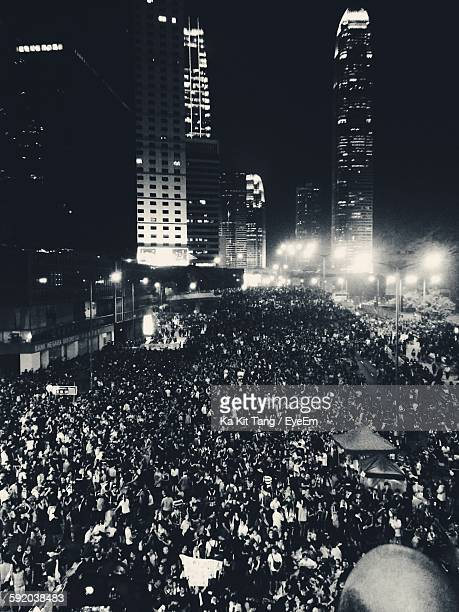 High Angle View Of People On Street Amidst Illuminated Buildings