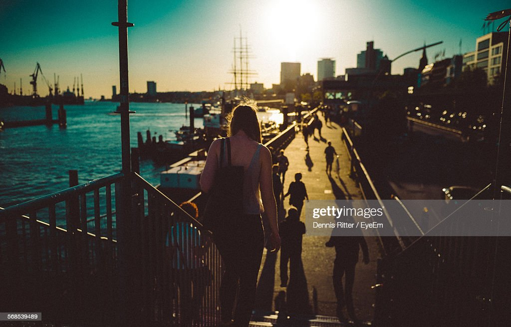 High Angle View Of People On Street By Sea In City : Stock Photo