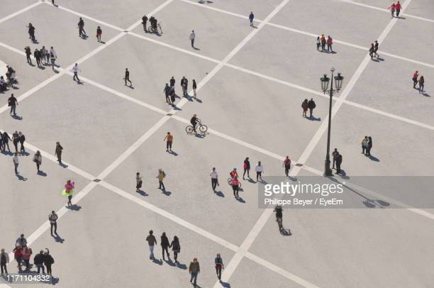high angle view of people on street in city - menschen stock-fotos und bilder