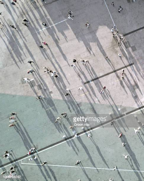high angle view of people on street - shadow stock pictures, royalty-free photos & images