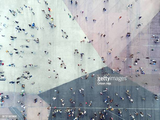 high angle view of people on street - drone stock pictures, royalty-free photos & images