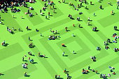 High Angle View Of People On Textured Green Field