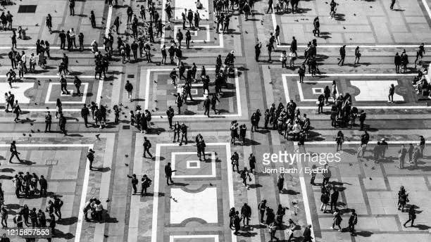 high angle view of people on tiled floor - milan stock pictures, royalty-free photos & images