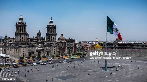 high angle view of people outside metropolitan cathedral against sky - mexican flag stock pictures, royalty-free photos & images