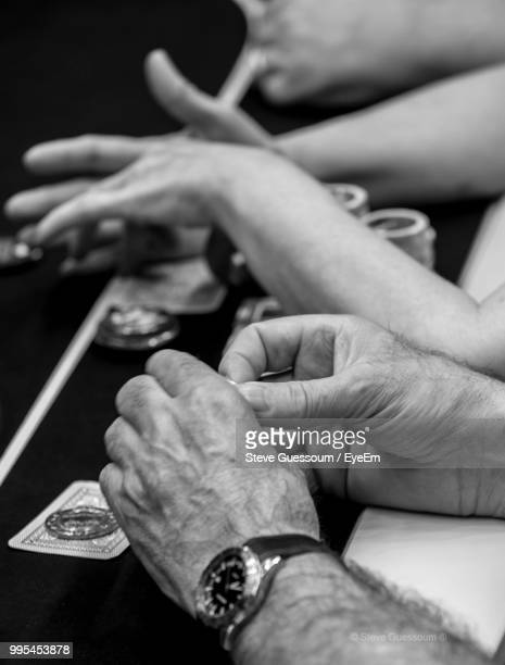 High Angle View Of People Playing Poker In Casino