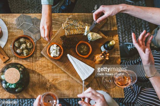 high angle view of people preparing food on cutting board - tapas stock photos and pictures