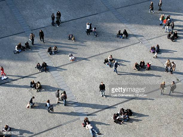 High Angle View Of People Relaxing On Town Square