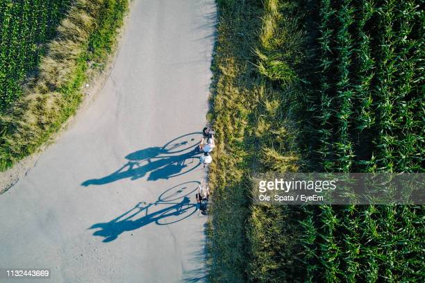 high angle view of people riding bicycle on road - ニーダーザクセン州 ストックフォトと画像
