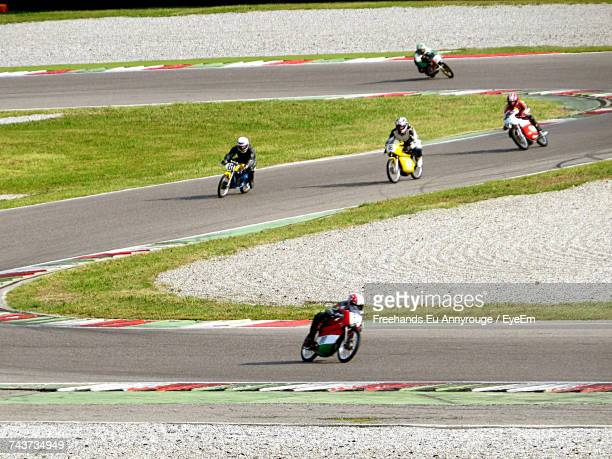 high angle view of people riding motorcycles on road - motorcycle racing stock pictures, royalty-free photos & images