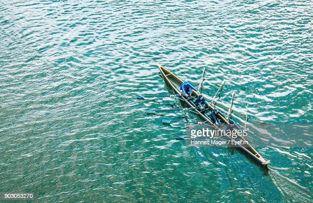 High Angle View Of People Rowing Boat On Sea