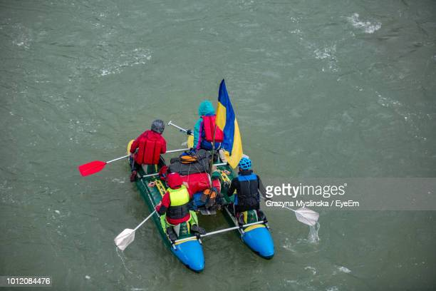 High Angle View Of People Sailing Boat On Sea