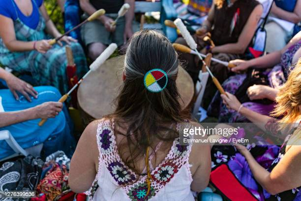 high angle view of people sitting at music festival - continent américain photos et images de collection
