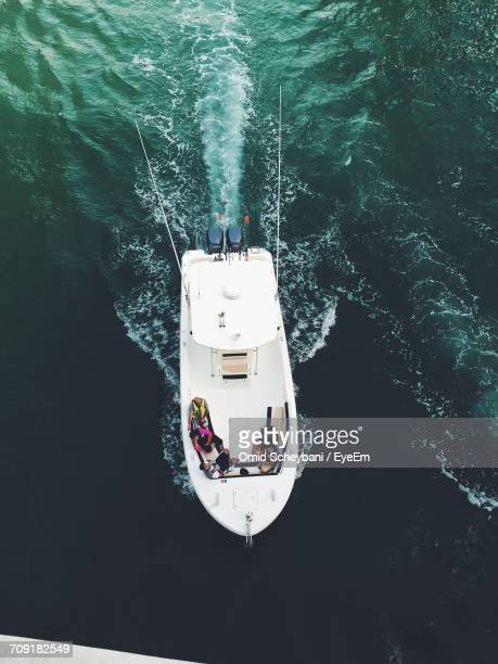 High Angle View Of People Sitting In Motorboat At Sea