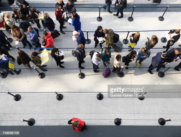 High Angle View Of People Standing At Airport
