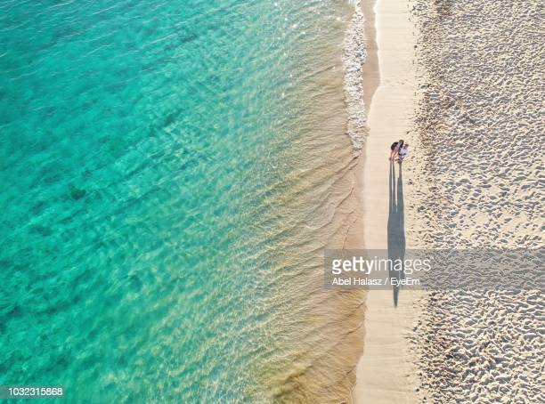 high angle view of people standing on beach - heterosexual couple stock pictures, royalty-free photos & images