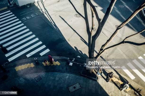 High Angle View Of People Standing On Footpath