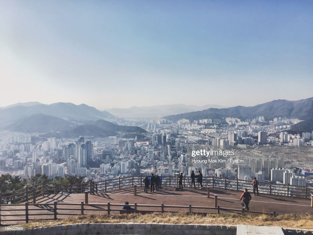 High Angle View Of People Standing On Observation Point Against Cityscape : Stock Photo