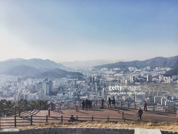 high angle view of people standing on observation point against cityscape - busan stock photos and pictures