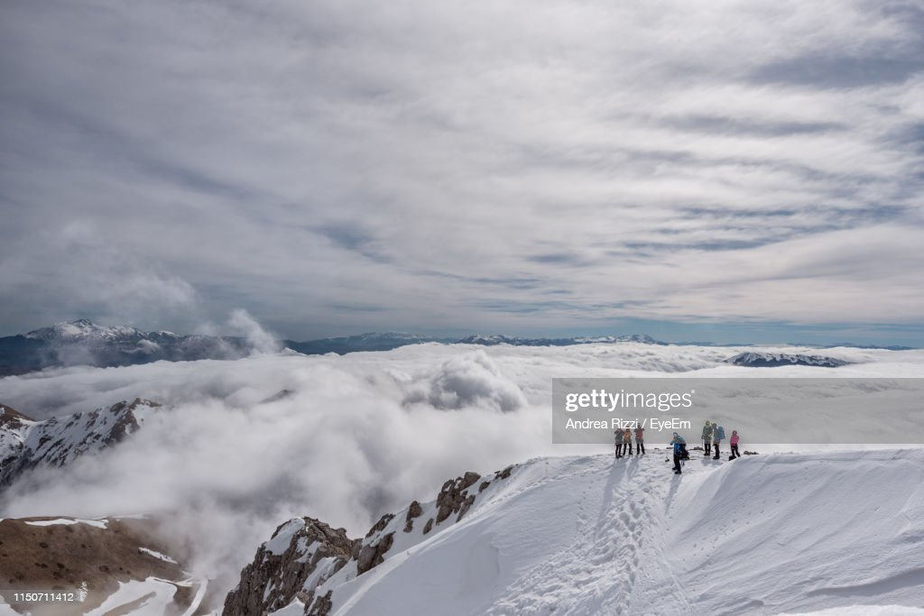 High Angle View Of People Standing On Snow Covered Mountain : Foto stock
