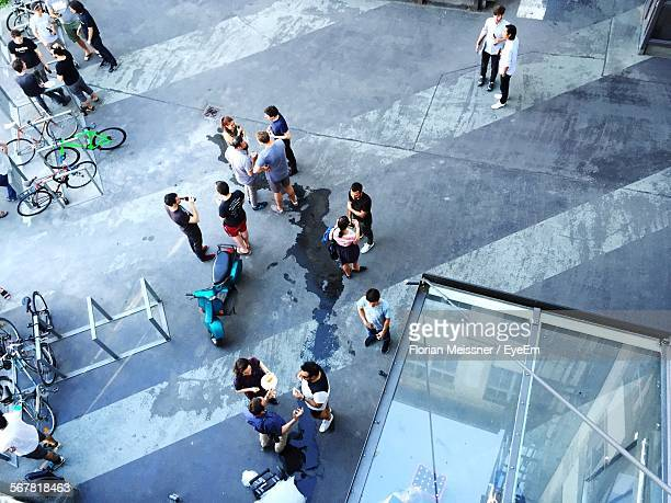 High Angle View Of People Standing On Street