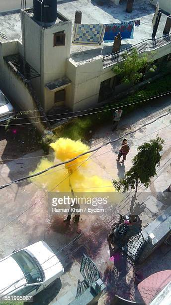 High Angle View Of People Throwing Color At Holi Festival