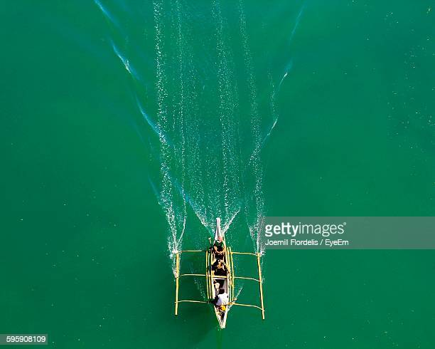 high angle view of people traveling in boat on river - joemill flordelis stock pictures, royalty-free photos & images
