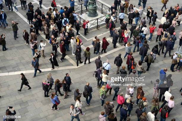 high angle view of people walking in city - affluence photos et images de collection