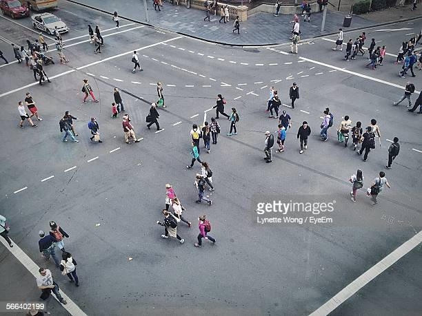 High Angle View Of People Walking On City Crossroad In Rush Hour