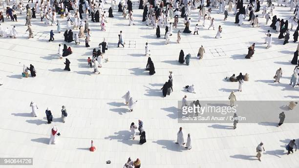 high angle view of people walking on facade - gulf countries stock pictures, royalty-free photos & images