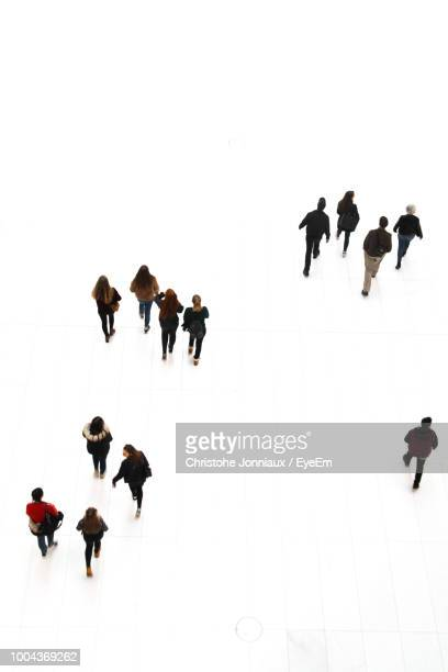 high angle view of people walking on floor - 俯瞰 ストックフォトと画像