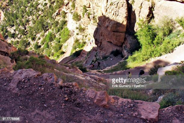 High Angle View Of People Walking On Road By Mountain