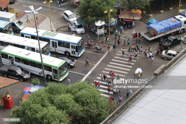 high angle view of people walking on road in city - マナウス ストックフォトと画像