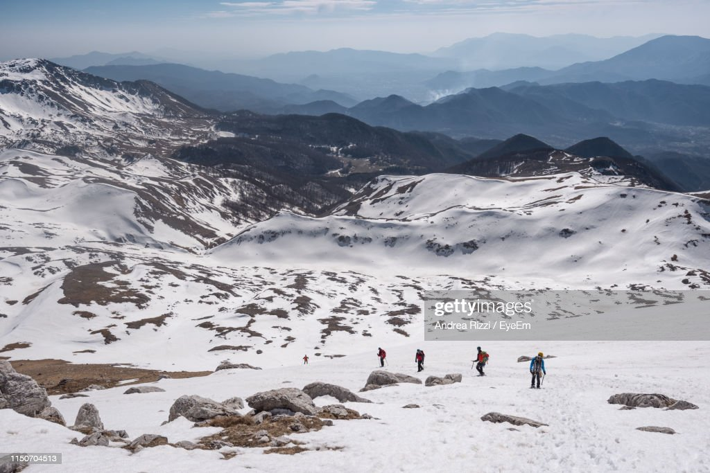 High Angle View Of People Walking On Snow Covered Land : Foto stock