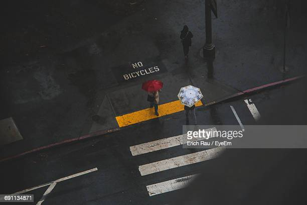 High Angle View Of People Walking On Street During Rain