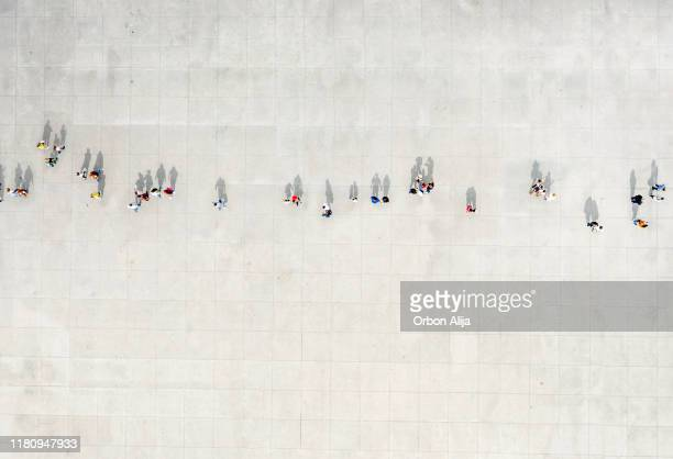 high angle view of people walking on street - high angle view stock pictures, royalty-free photos & images