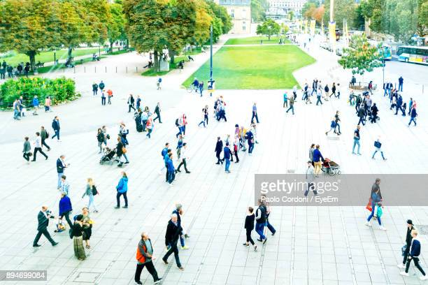 high angle view of people walking on street - baden württemberg stock-fotos und bilder