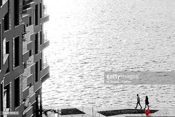 high angle view of people walking on walkway against sea - isolated color stock pictures, royalty-free photos & images