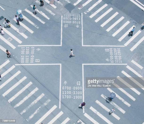 high angle view of people walking on zebra crossing - taiwan stock photos and pictures