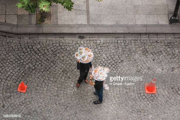 High Angle View Of People With Food Standing On Street
