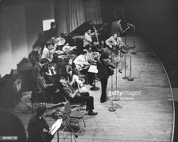 High angle view of performers on the stage for a woody Guthire tribute at Carnegie Hall New York New York January 20 1968 Among those pictured are...