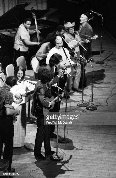 High angle view of performers on the stage for the 'A Tribute to Woody Guthrie' concert at Carnegie Hall New York New York January 20 1968 Among...
