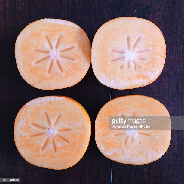 High Angle View Of Persimmon Slices On Table